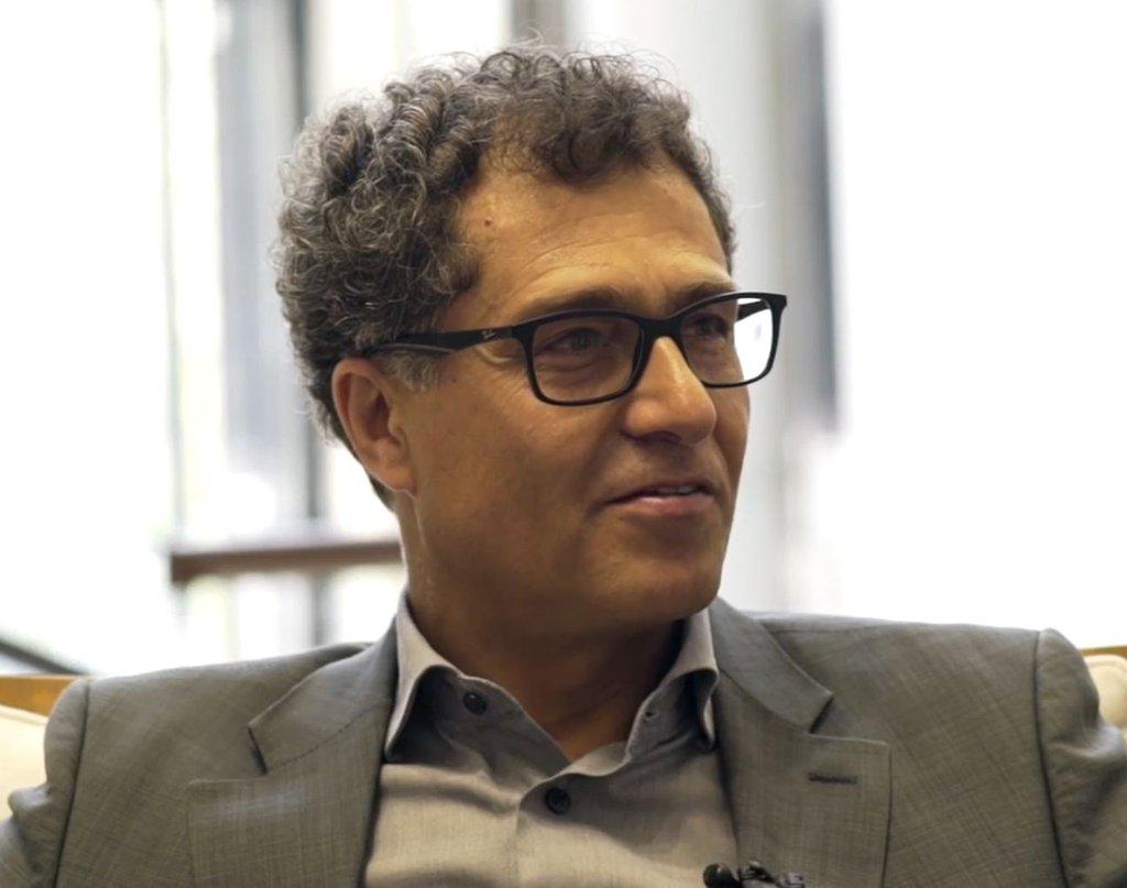 Headshot of seated Sam Khola